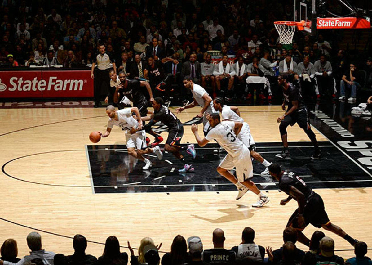 Tony Parker (with ball) and the Spurs will look to push the pace in a matchup of two premier offenses.
