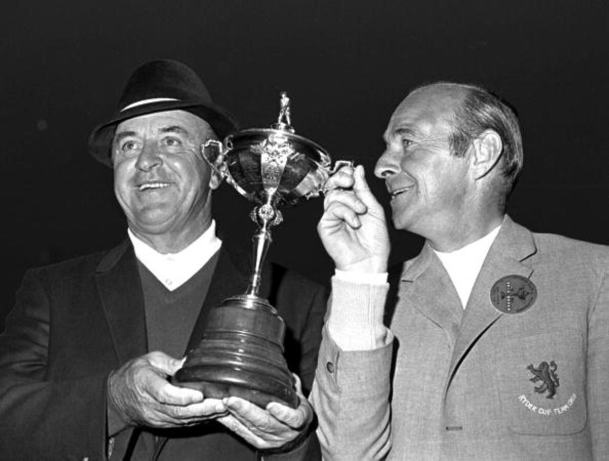 1969 Ryder Cup at Birkdale, US Captain Sam Snead pictured holding the trophy with Britain's Eric Brown after American and British teams tied.