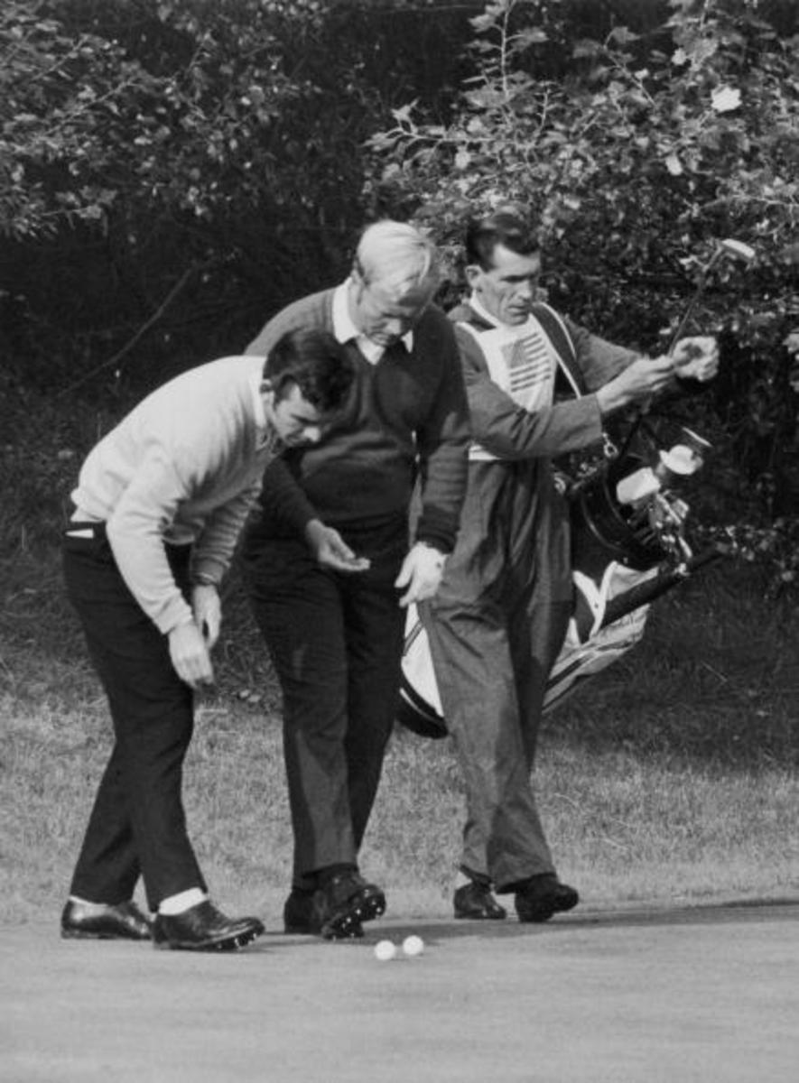 Golfing rivals Tony Jacklin (left) of Britain and Jack Nicklaus of the USA marking their balls after they had played their shot within inches of each other during the Ryder Cup at Royal Birkdale, Lancashire