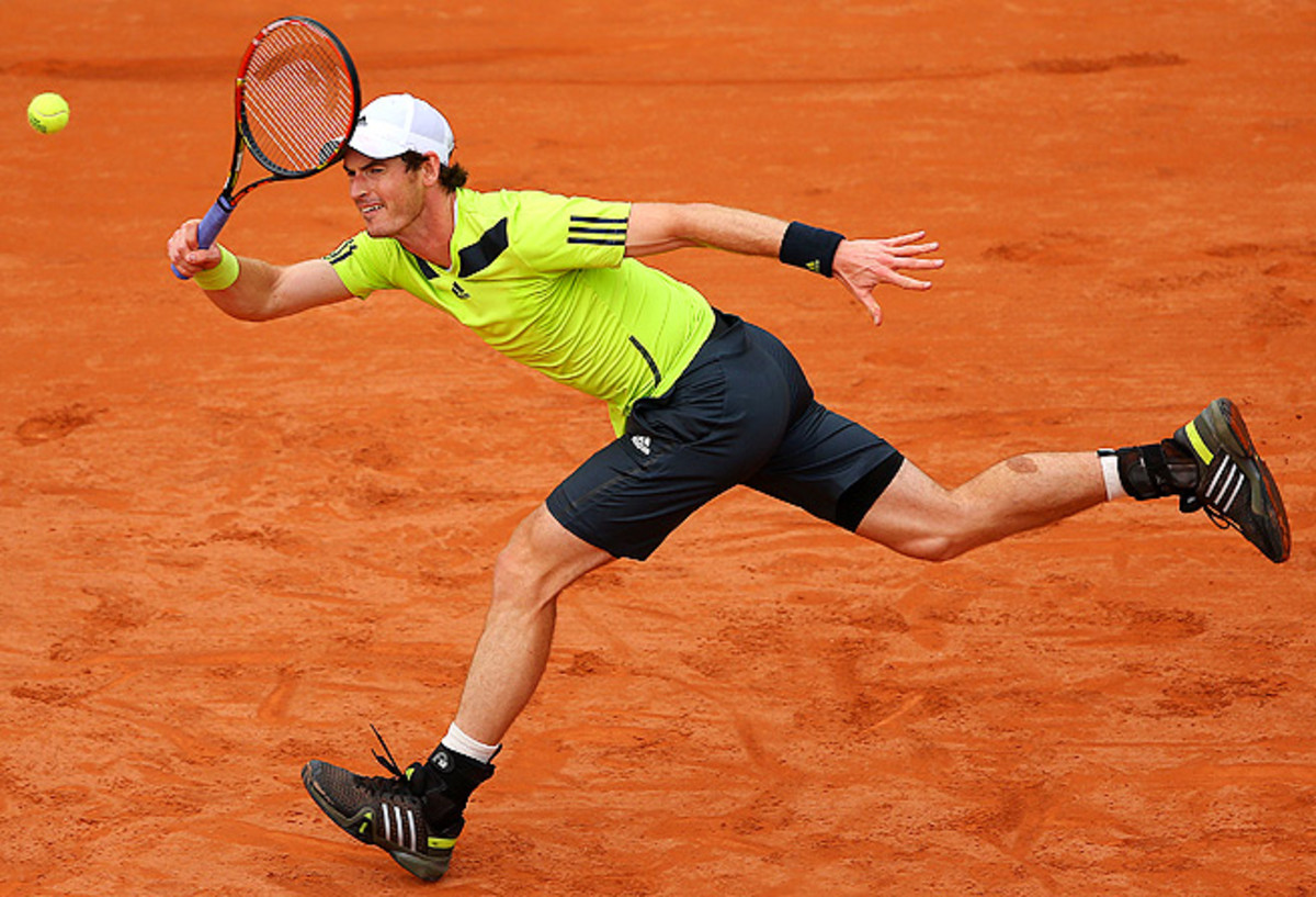 Wimbledon champ Andy Murray had no problems in his first-round match, beating Andrey Golubev in straight sets.