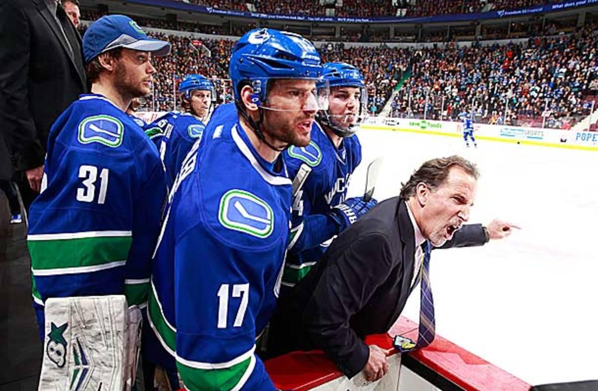 Coach John Tortorella of the Vancouver Canucks screams at Calgary Flames coach Bob Hartley.