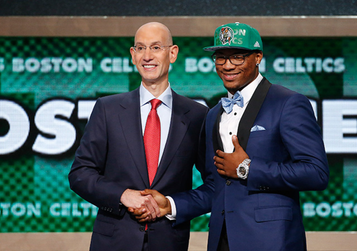 Oklahoma State's Marcus Smart, right, poses for a photo with NBA commissioner Adam Silver after being selected sixth overall by the Boston Celtics during the 2014 NBA draft.