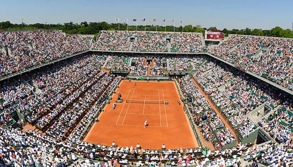 The clay courts at Roland Garros require quite a bit of maintenance throughout the French Open. (Bob Martin/SI)
