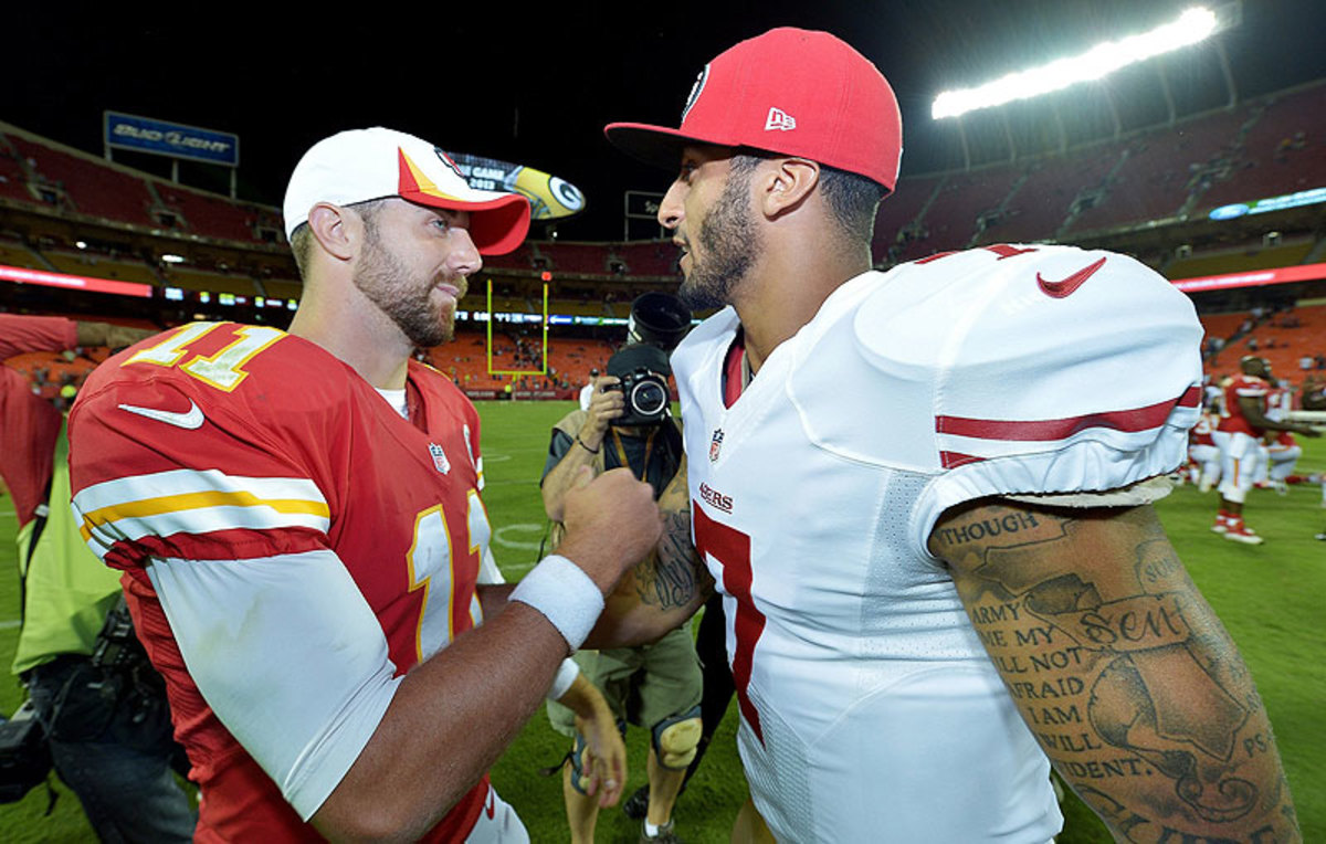 Alex Smith and Colin Kaepernick, here after a 2013 preseason game, were teammates on the 49ers in 2011-12. (John Sleezer/Getty Images)