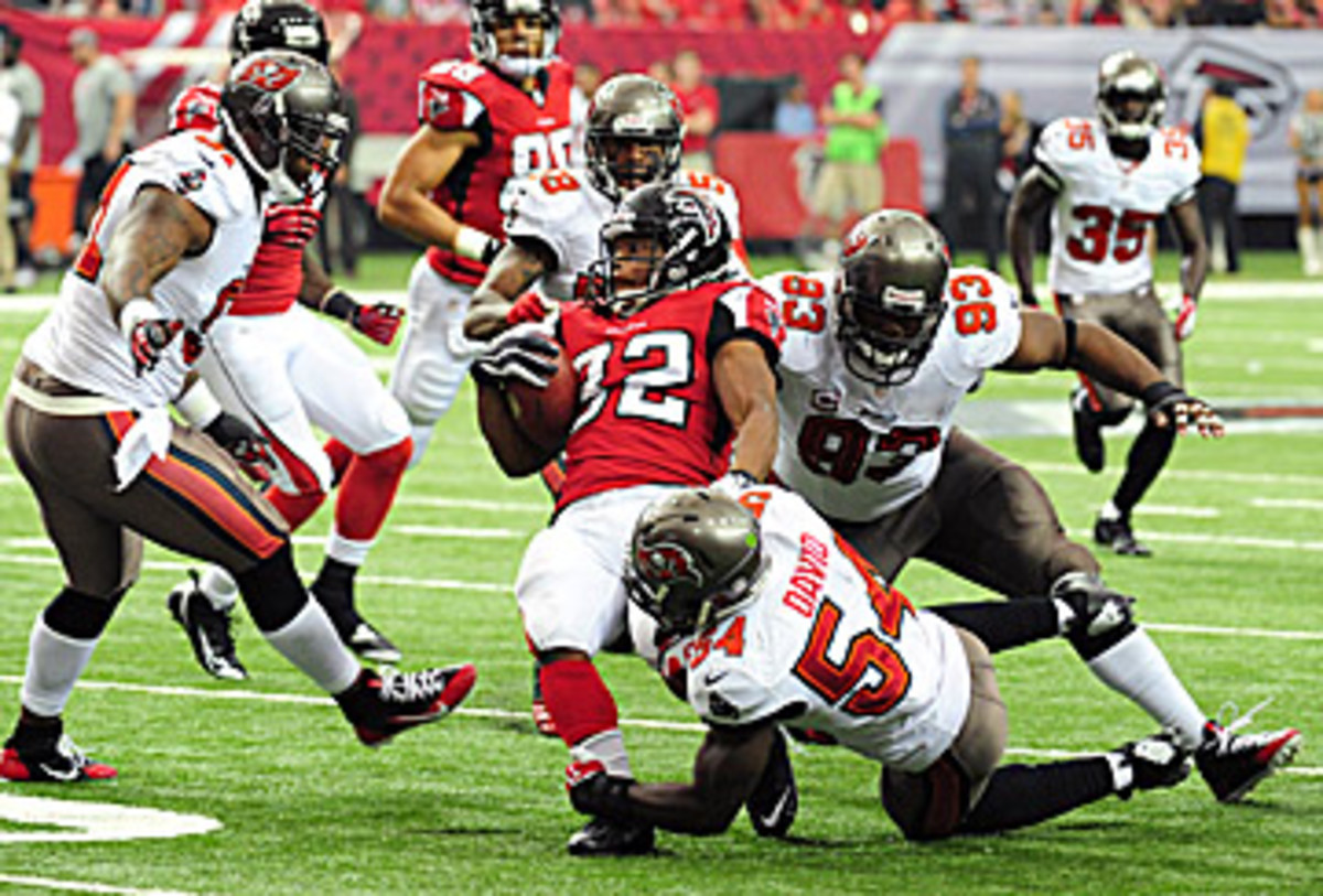 Gerald McCoy (93) and Lavonte David (54) lead a talented Bucs defense. (Scott Cunningham/Getty Images)