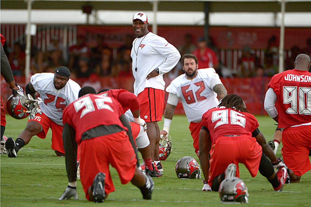 Lovie Smith is all smiles for his return to the NFL. (Phelan M. Ebenhack)