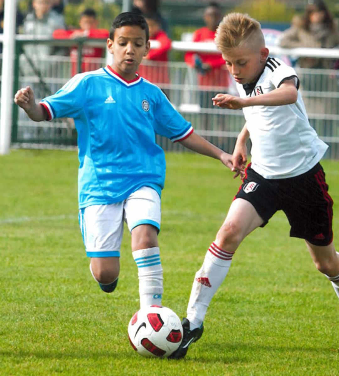 10-year-old Michael Moravek, right, gets an early start on his Fulham career.