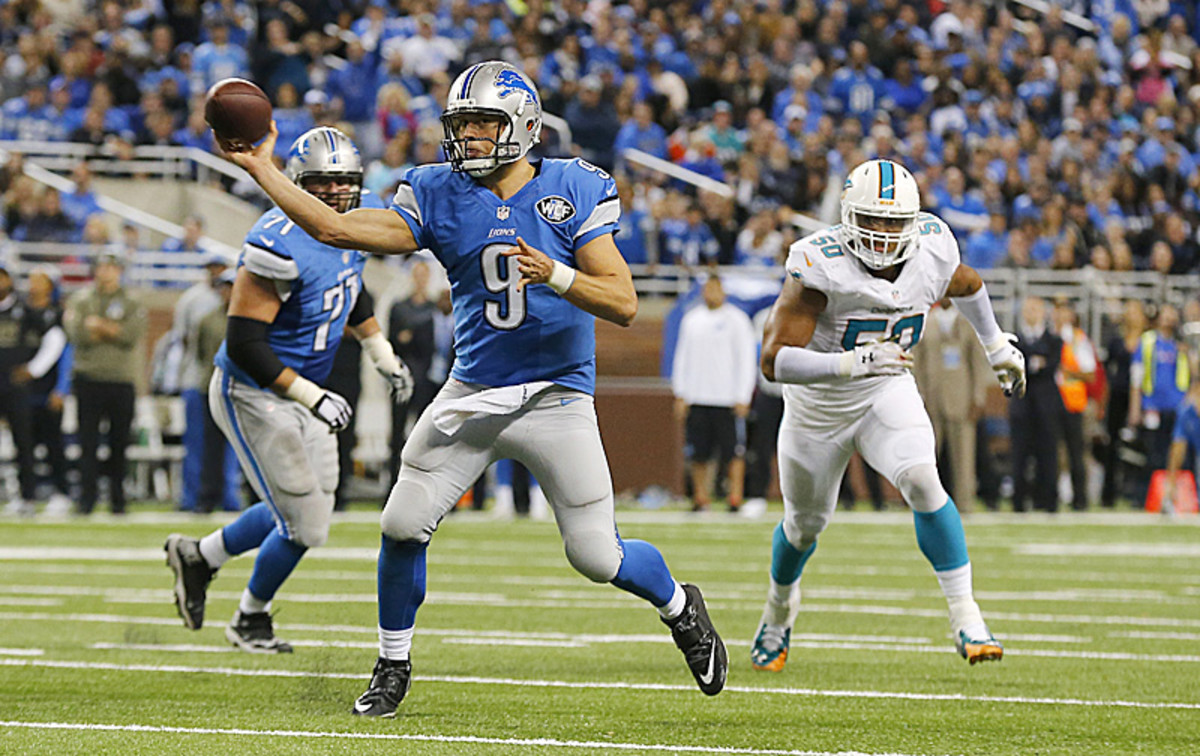 Matthew Stafford winged a sidearm pass on the run for the game-winner on Sunday. (Duane Burleson/AP)