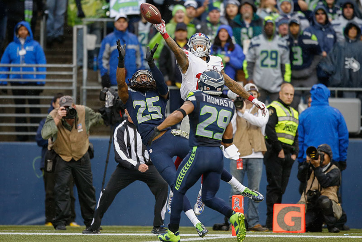 Richard Sherman's tip on a pass intended for Odel Beckham resulted in an Earl Thomas interception in the end zone. (Otto Greule Jr./Getty Images)