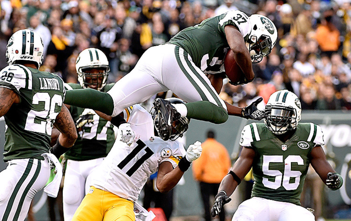 Jaiquawn Jarrett and the Jets defense forced four turnovers Sunday, one more than they'd forced all season. (Al Bello/Getty Images)