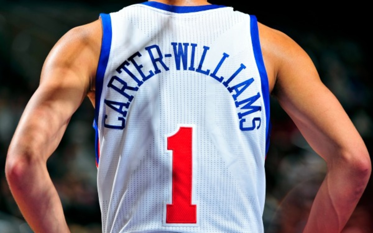 Rookie Michael Carter-Williams helped Philadelphia evade the title of NBA's losingest team in history. (David Dow/Getty Images)
