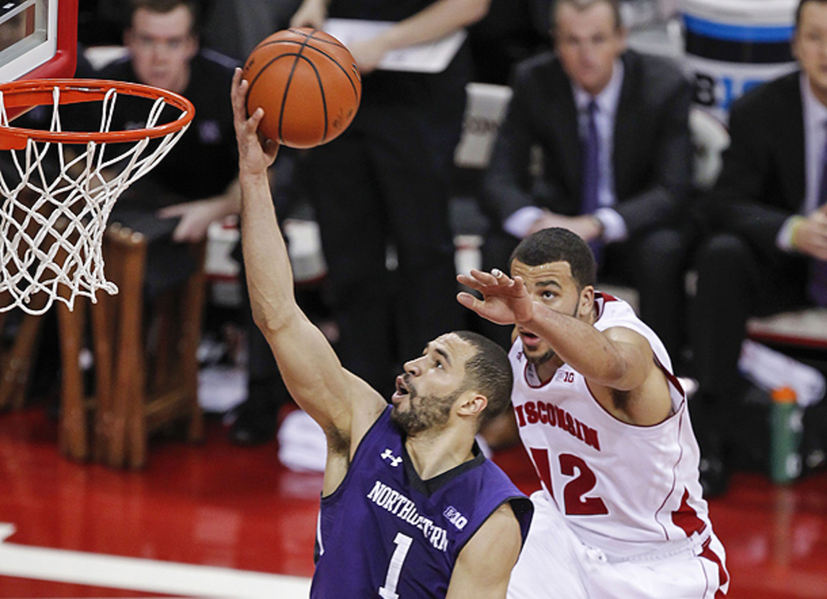 Northwestern found ways to get easy buckets against Wisconsin, while the Badgers struggled to score. (Andy Manis/AP)