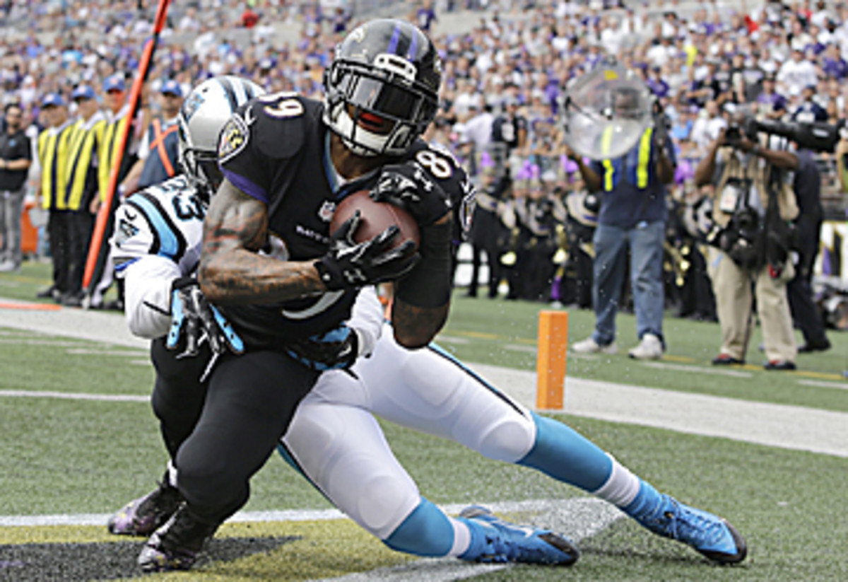 Smith hauled in his second TD pass despite defensive pass interference. (Patrick Semansky/AP)