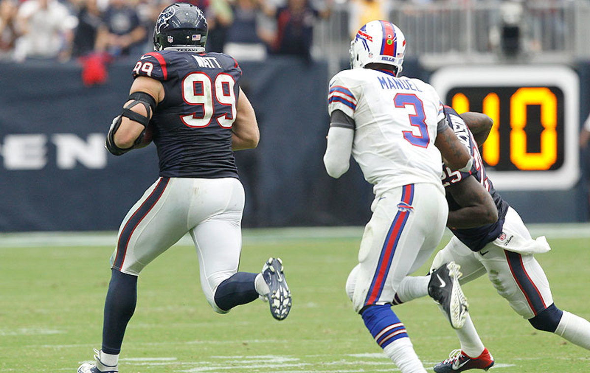 J.J. Watt had an interception return for a touchdown as the Texans improved to 3-1 with a win over the Bills on Sunday. (Bob Levey/Getty Images)