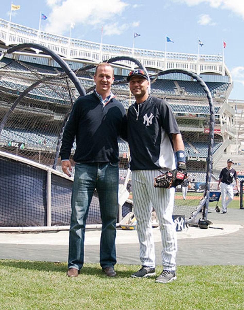Peyton Manning visited Jeter at Yankee Stadium in May. (Tomasso DeRosa/AP)