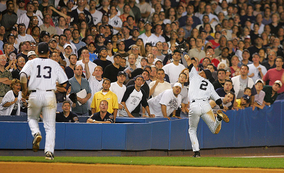 This catch in the 2004 playoffs ended with Jeter bloodied after a head-first dive into the stands. (Ezra Shaw/Getty Images)
