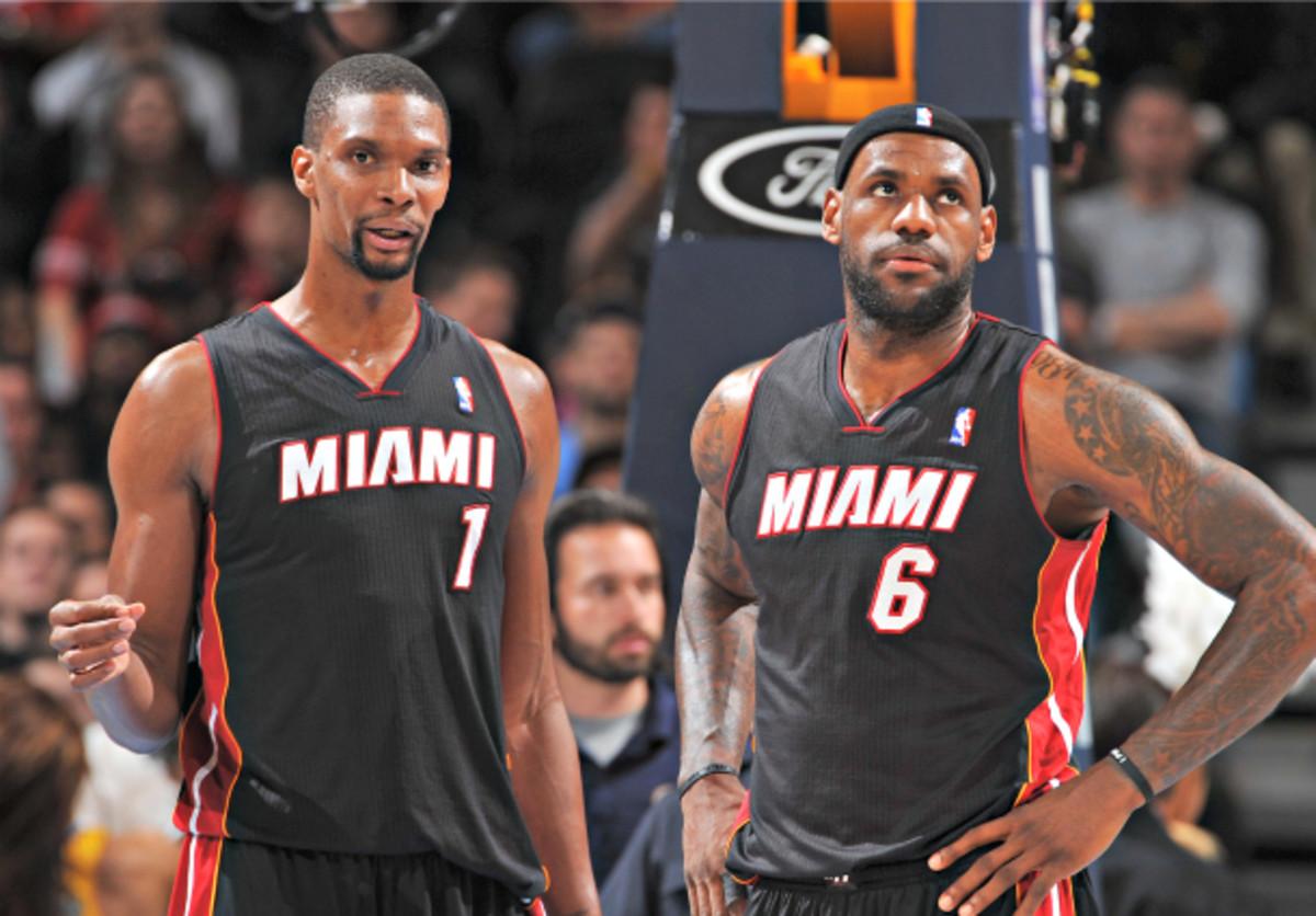 Chris Bosh thinks both he and LeBron James will be in Miami next season. (Garrett W. Ellwood/NBAE via Getty Images)