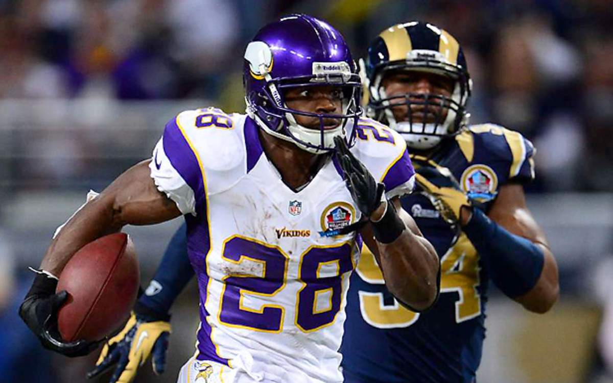 Adrian Peterson is one of seven players to ever rush for 2,000 yards in a season. (John Biever/SI)