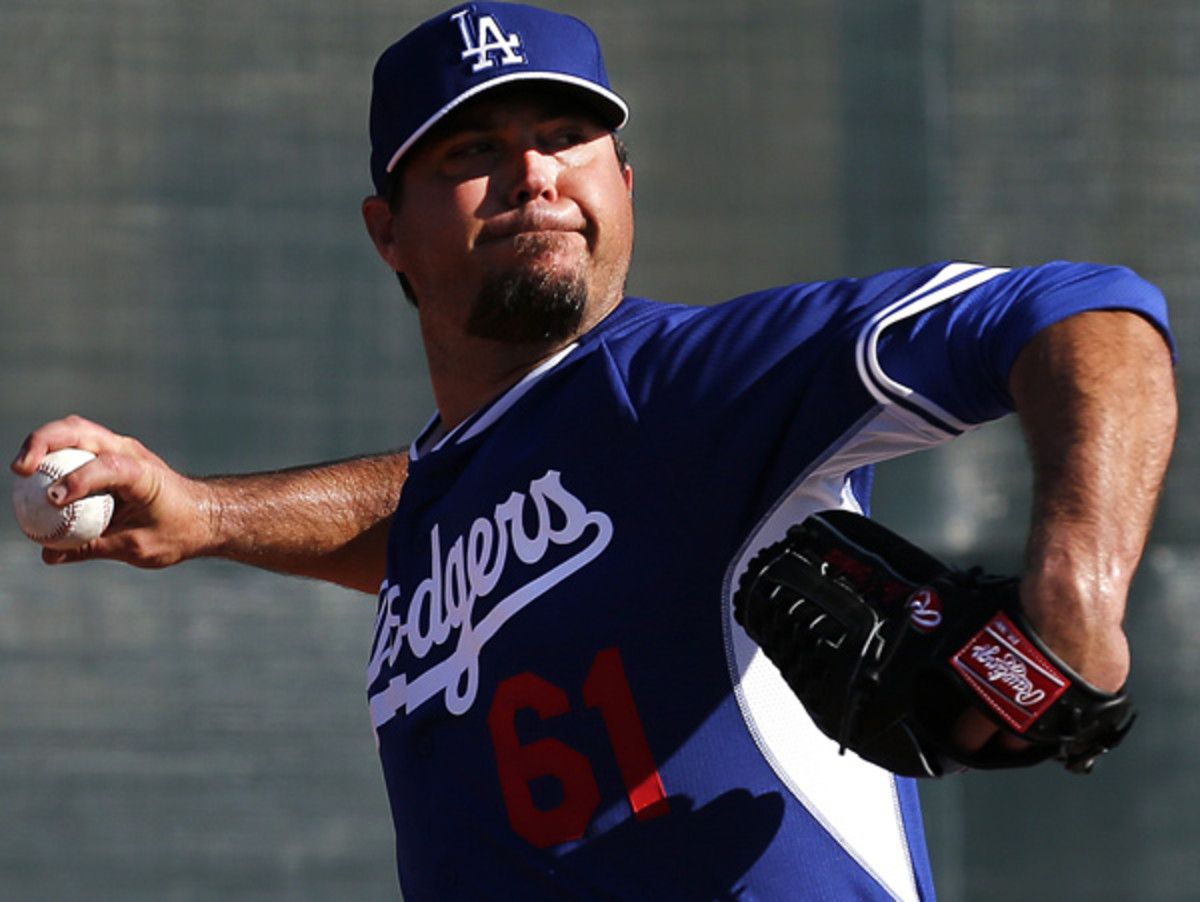 Josh Beckett saw his 2013 cut short by thoracic outlet syndrome in his shoulder. (Paul Sancya/AP)