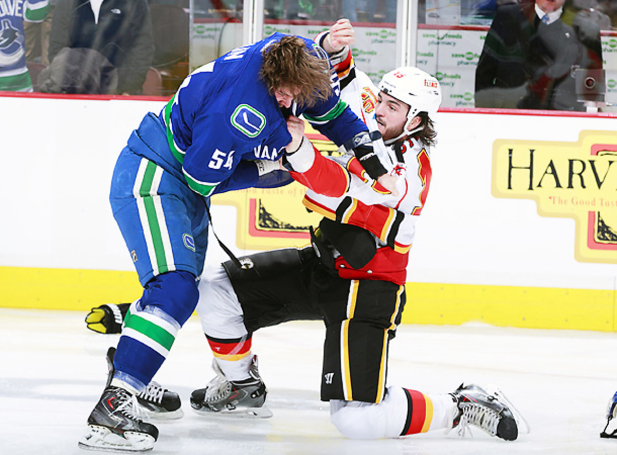 Kellan Lain (left) was ejected two seconds into his NHL debut after his role in Saturday's line brawl. (Jeff Vinnick/Getty)