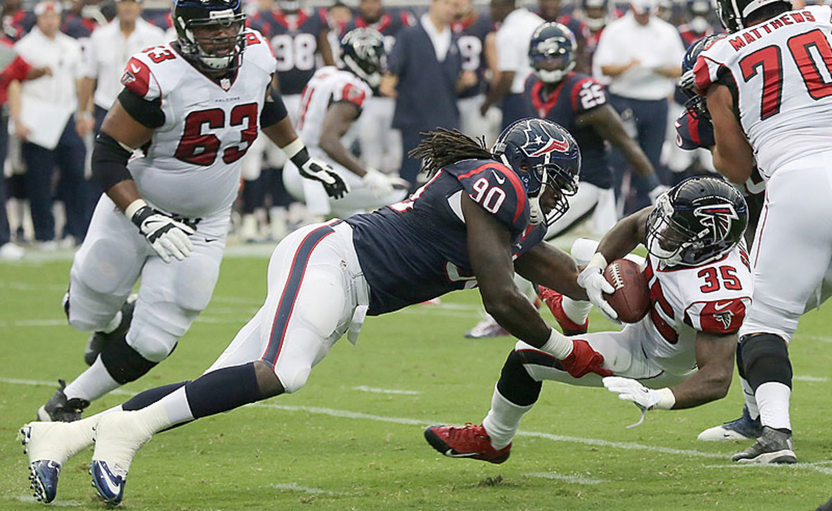 In Saturday's game, Jadeveon Clowney de-cleated Falcons RB Antone Smith, who later called the Texans rookie 'just a guy.' (Bob Levey/Getty Images)