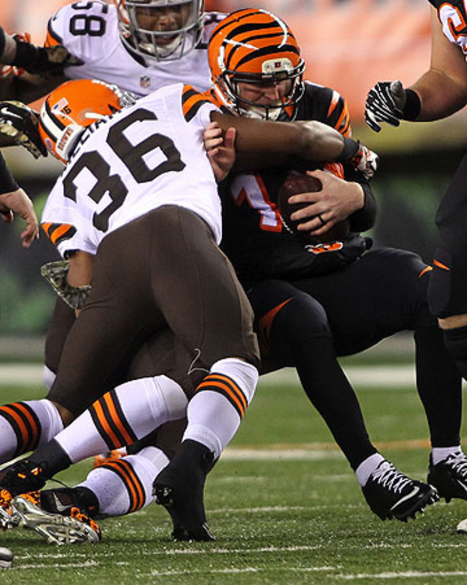 Andy Dalton was sacked twice by the Browns defense on Thursday night. (John Grieshop/Getty Images)