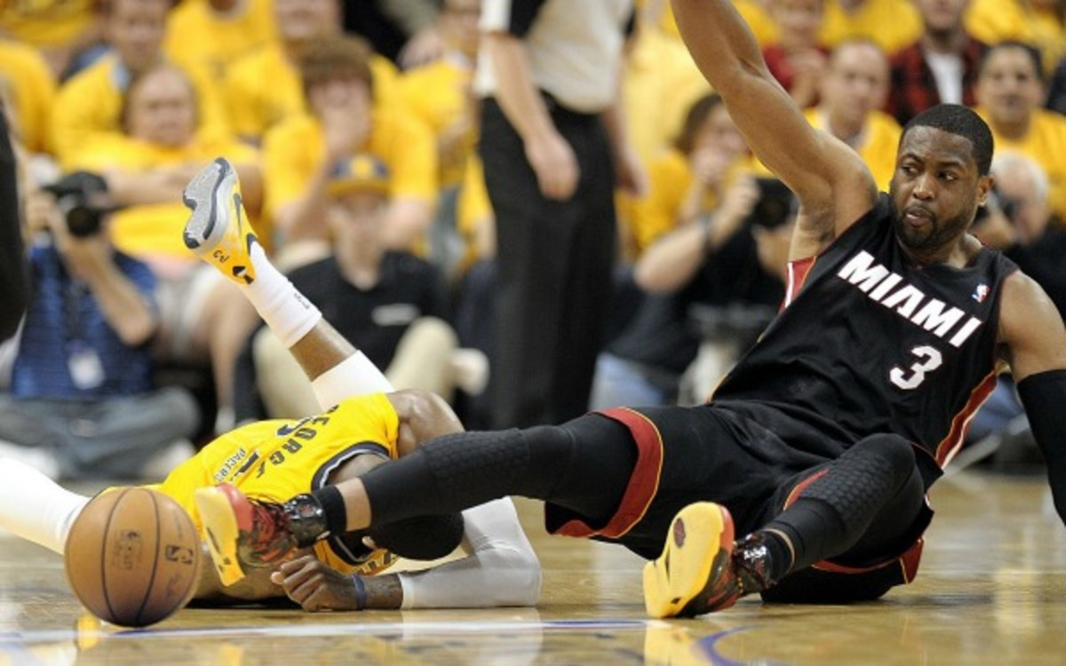 Paul George went down Tuesday night after getting hit in the head by Dwyane Wade's knee. (Sun Sentinel/Getty Images)
