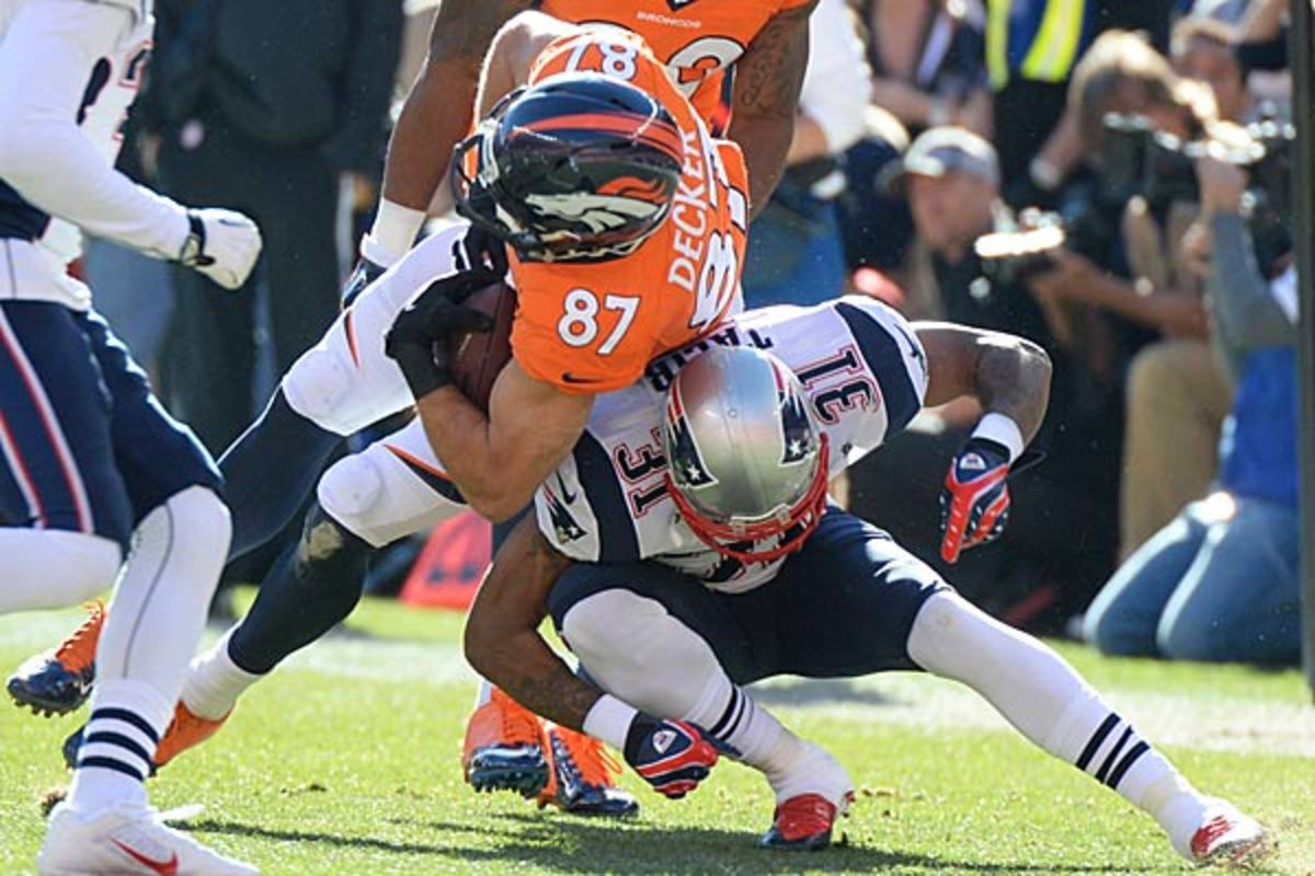 Aqib Talib (right) is a critical component of the New England secondary. (David E. Klutho/SI)