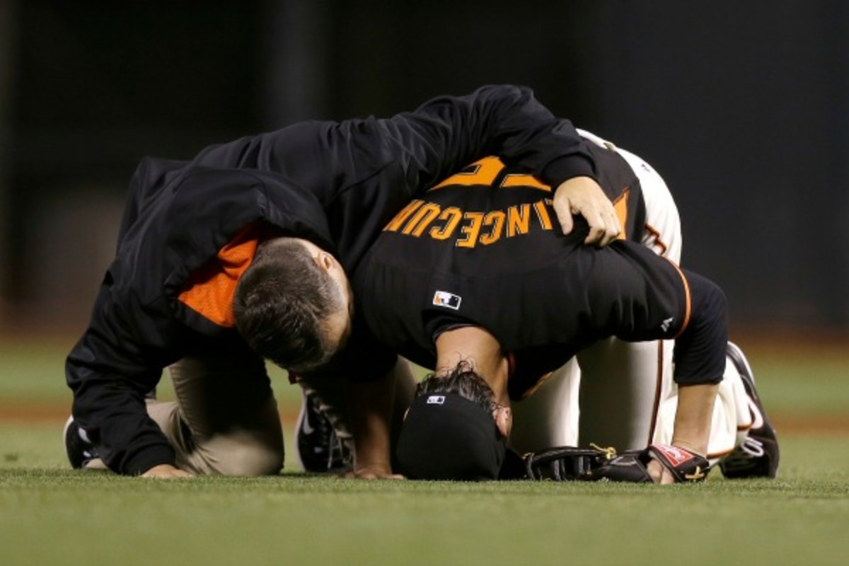 Tim Lincecum was in obvious pain after being hit by a comebacker on Friday night. (Jeff Chiu/Getty Images)