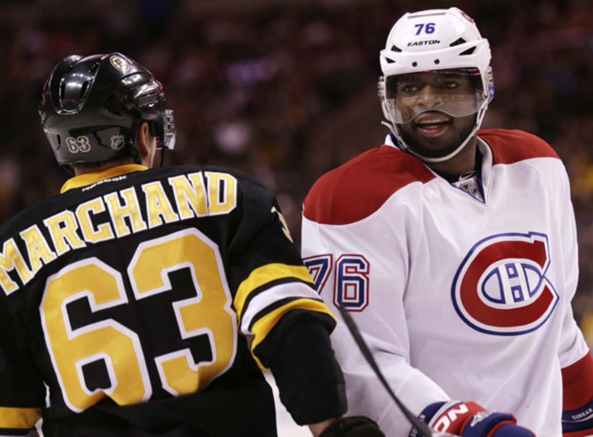 Brad Marchand and P.K. Subban jaw during another feisty game between Boston and Montreal. (Charles Krupa/AP)
