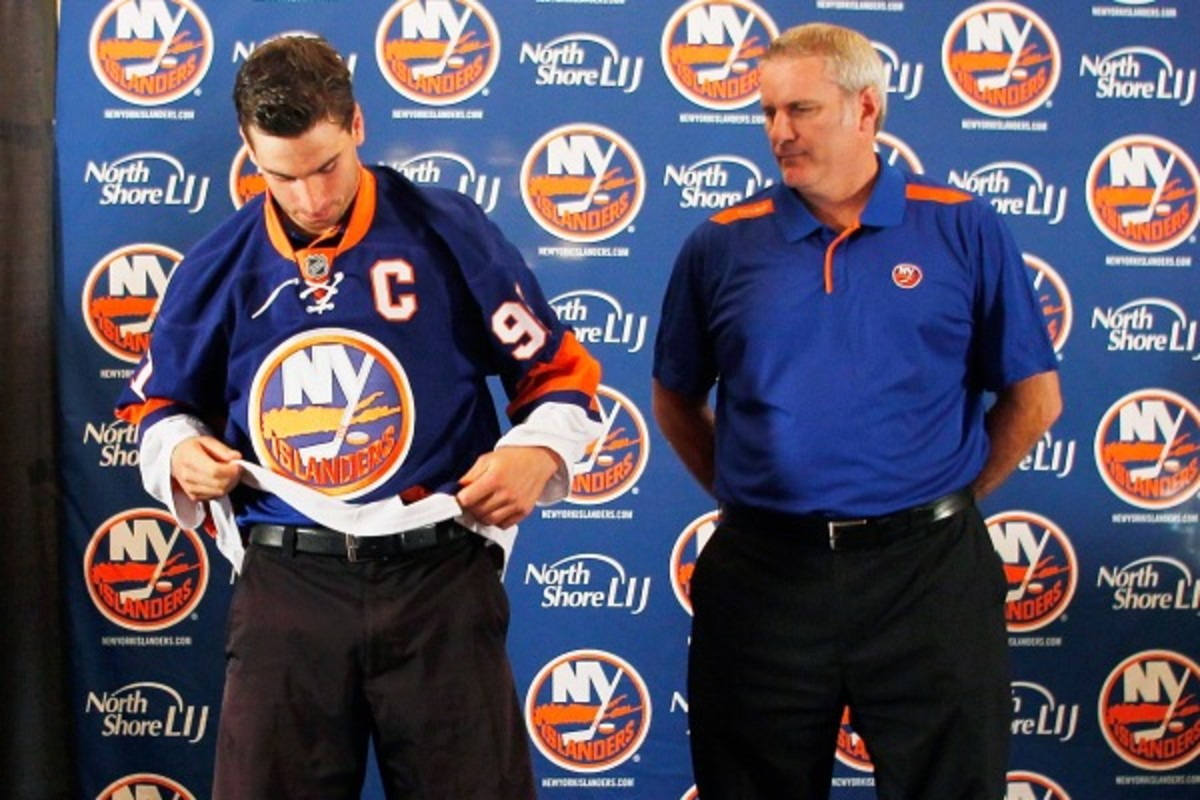 Garth Snow (right) and the Islanders named John Tavares captain last September. (Andy Marlin/Getty Images)