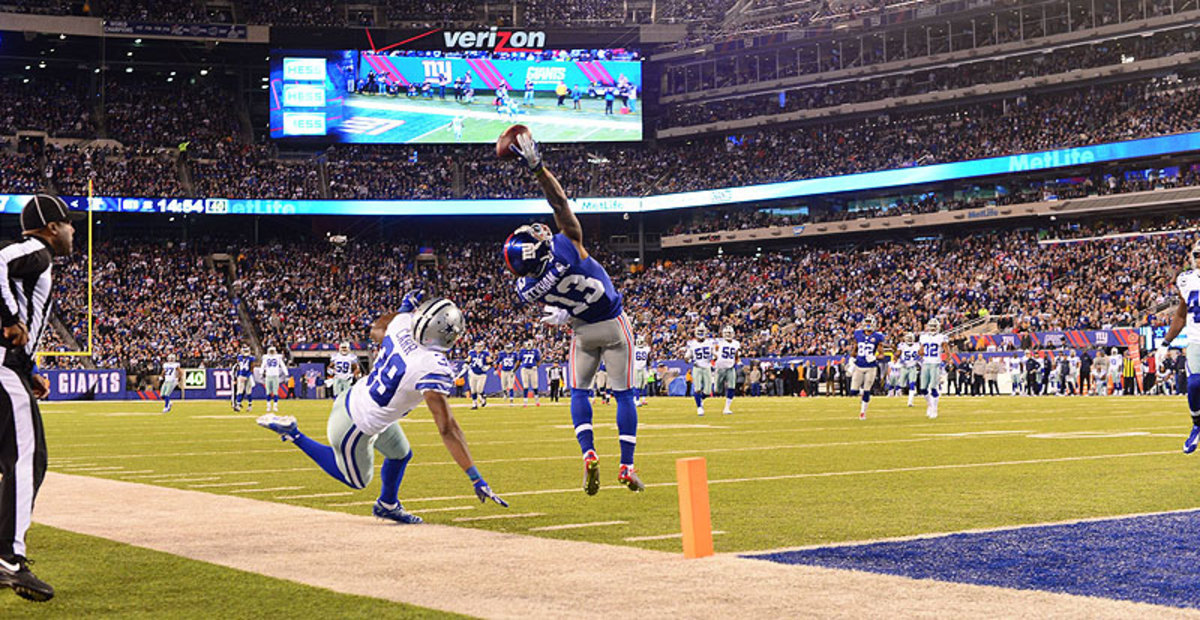 Odell Beckham's final 2014 stat line: 91 catches, 1,303 yards and 12 touchdowns ... and four games missed. (Carlos M. Saavedra/Sports Illustrated/The MMQB)