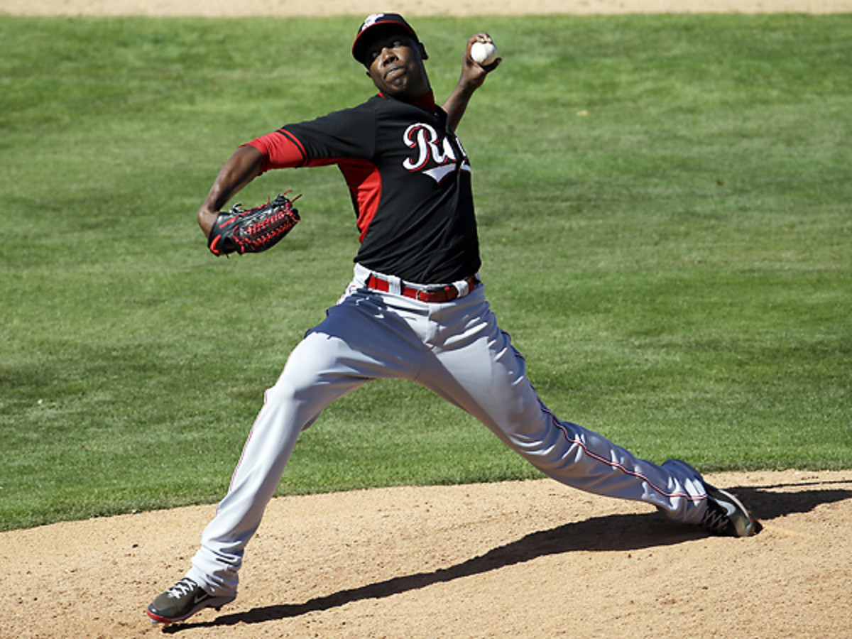Aroldis Chapman was carted off of the field after he was struck in the head by a line drive. (Morry Gash/AP)