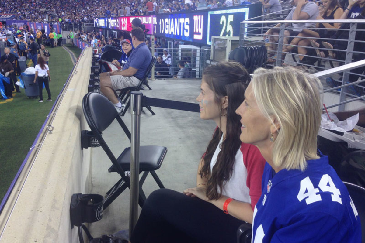 Soon-to-be wife KOMING and her mom had a front-row perch to watch Williams on Thursday. (Jenny Vrentas/The MMQB)