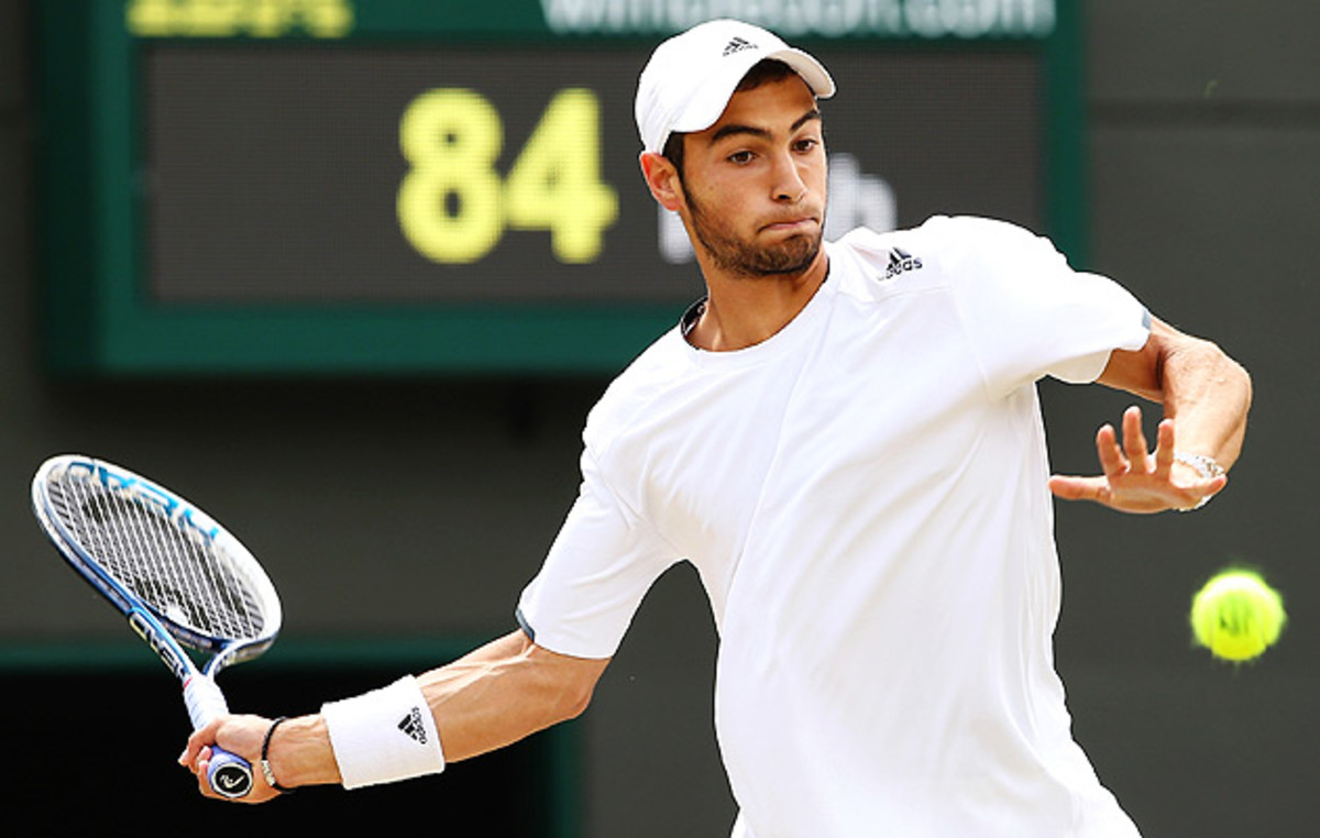 Noah Rubin returns a shot to Stefan Kozlov during the Wimbledon Boys' singles final.