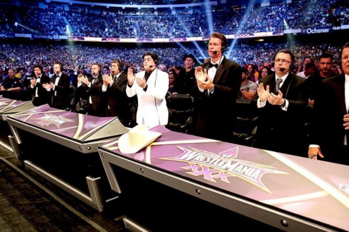 The WWE announcing crew pay respects to The Undertaker following his loss -- likely his last match. Photo credit: WWE.com