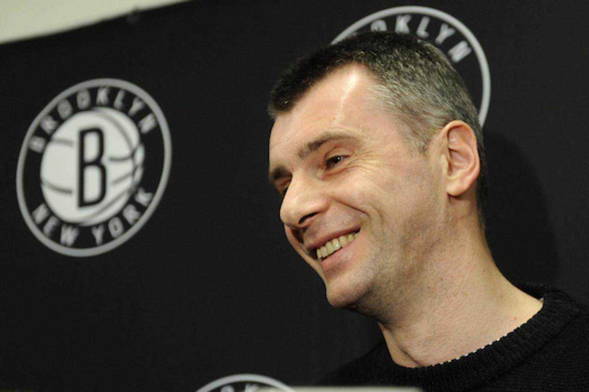 Prokhorov speaks to press during a Nets game in 2012 (Kathy Kmonicek/AP)