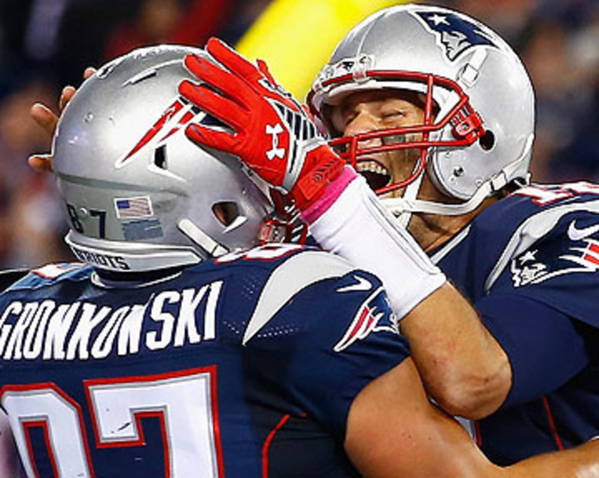 Brady and Rob Gronkowski connected six times for 100 yards and a touchdown. (Jared Wickerham/Getty Images)