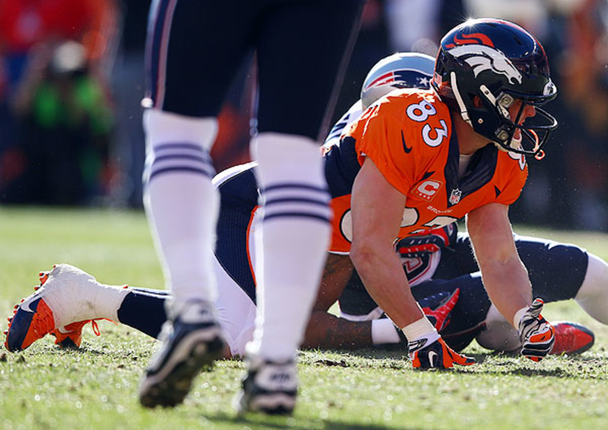Wes Welker (top) knocked Aqib Talib from the AFC title game on an early 'rub' route.