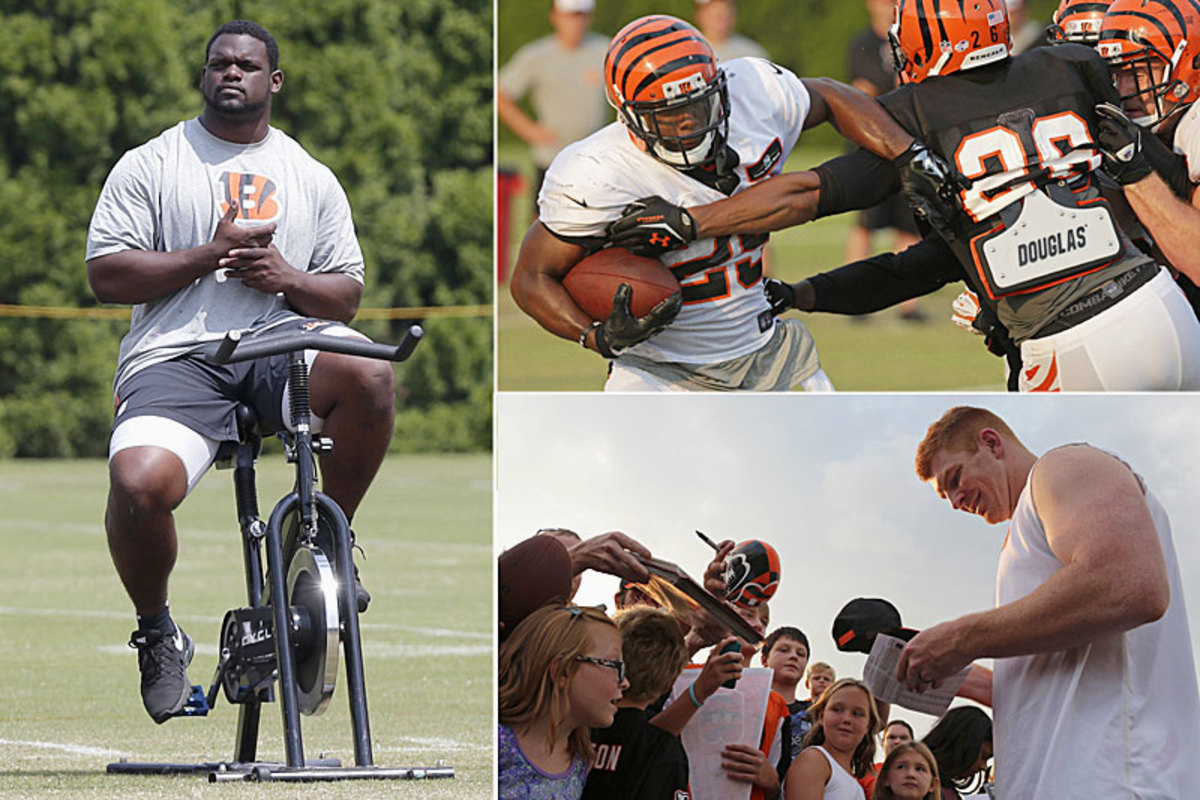 Clockwise from left: Geno Atkins keeping his knee warm on a bike, running back Giovani Bernard trying to break a tackle, and Andy Dalton signing autographs. (Al Behrman/AP :: 3)