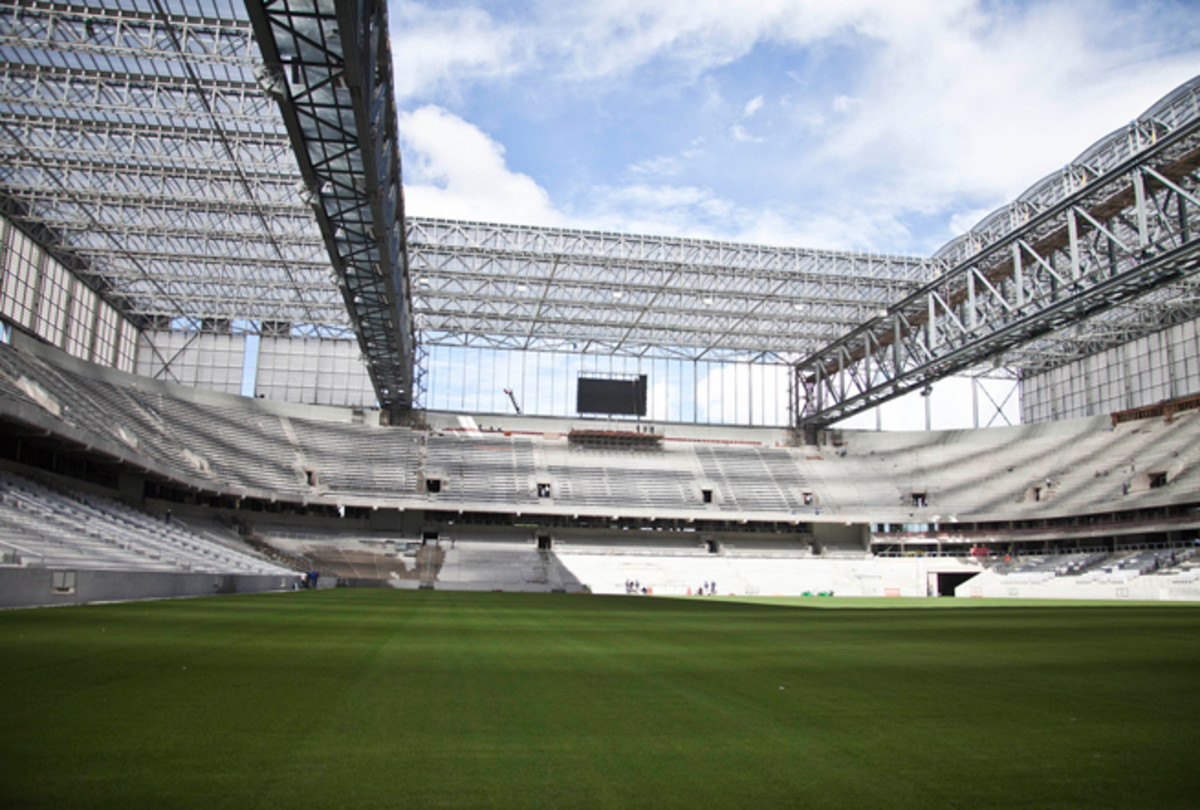Workers at Curitiba's Arena da Baixada have gone on strike over unpaid wages. The stadium remains under construction ahead of this summer's World Cup.