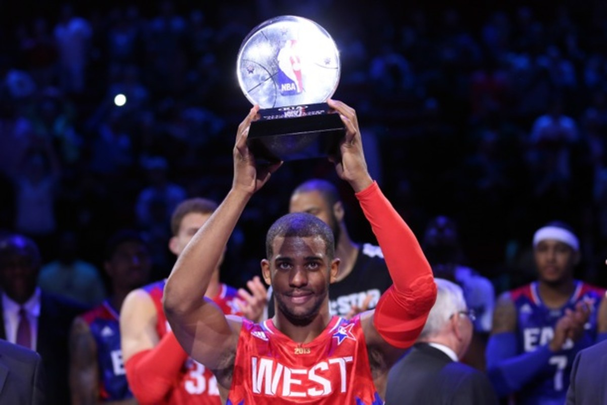 Chris Paul holds the 2013 All-Star Game MVP trophy. (Ronald Martinez/Getty Images)