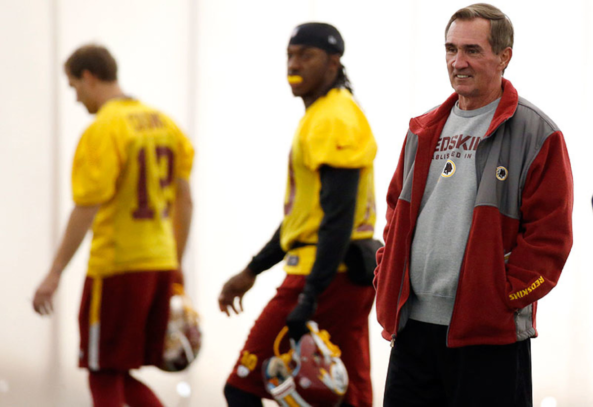With Washington sitting at 3-10, Mike Shanahan decided to bench star quarterback Robert Griffin III in favor of backup Kirk Cousins for the remainder of the season. (Alex Brandon/AP)