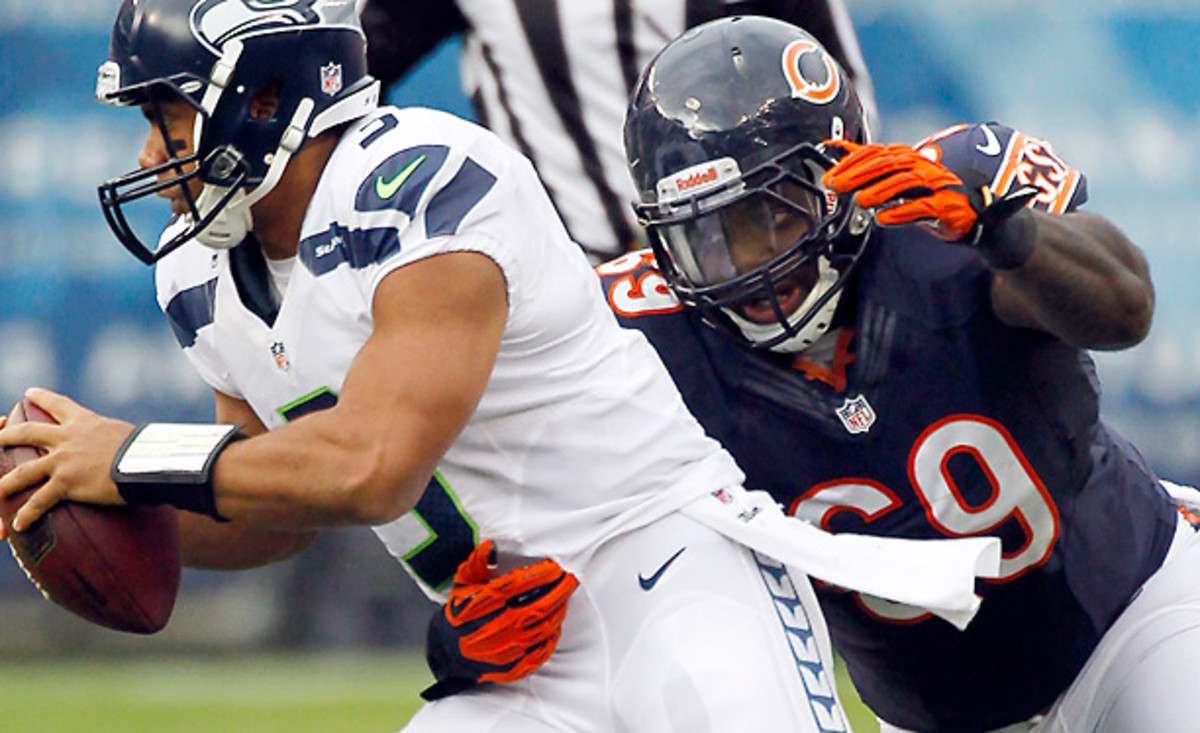 Would the Bears risk losing Brian Urlacher? Maybe, if it means keeping Henry Melton. (Charles Rex Arbogast/AP)