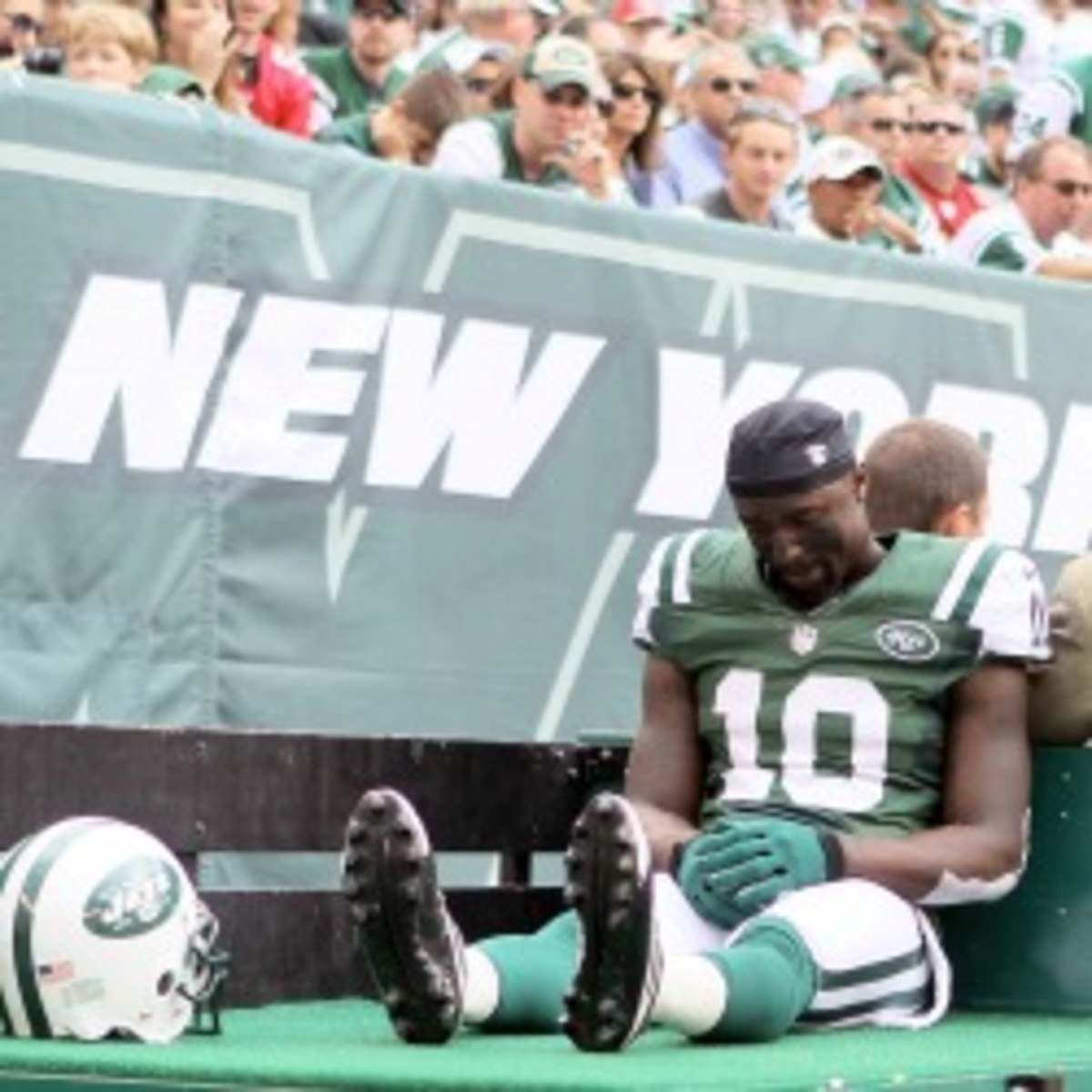 The Jets will reportedly try to restructure Santonio Holmes' contract this offseason. (Elsa/Getty Images)