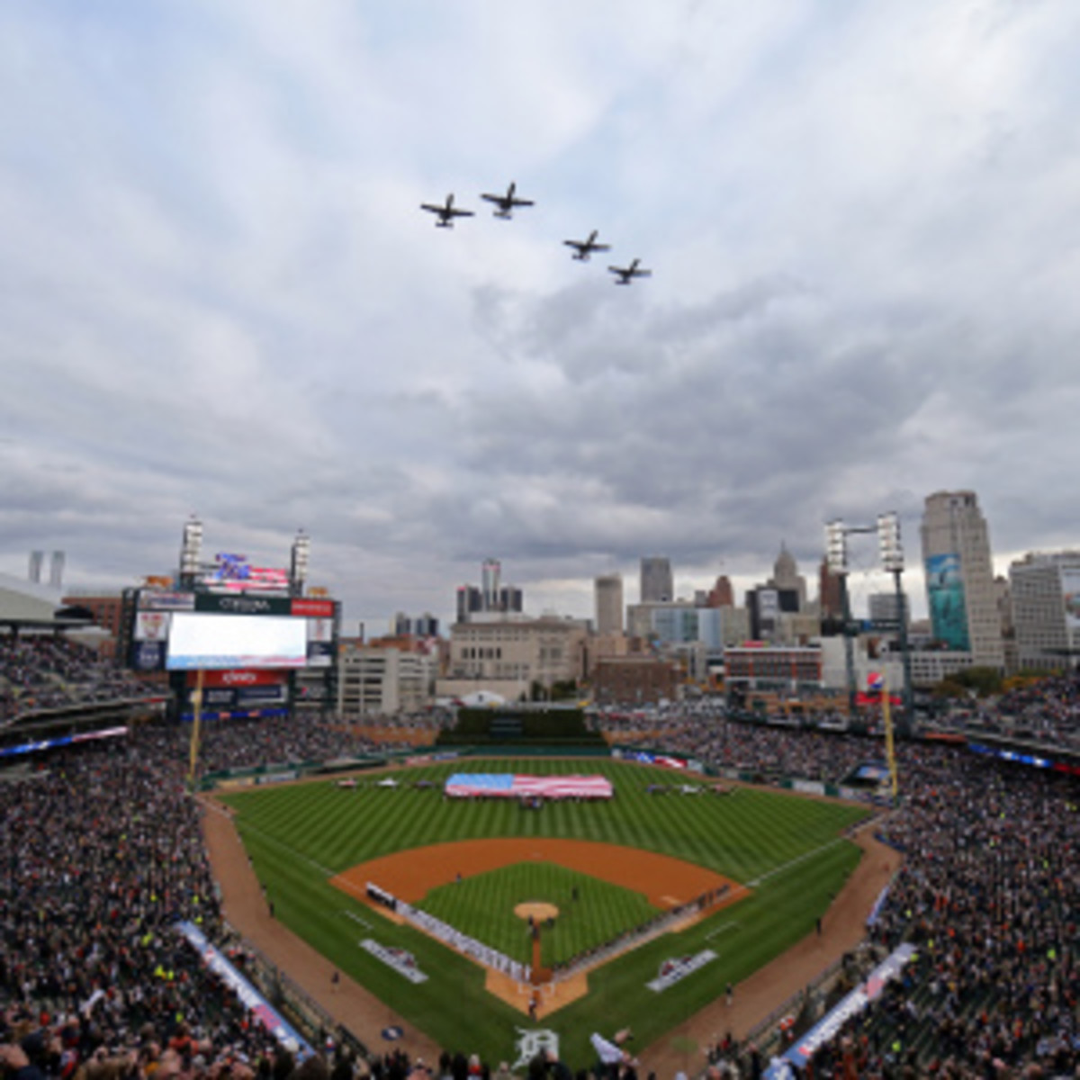 Military flyovers at sporting events, like these aircrafts appearing during the National Anthem at a Tigers-Athletics 2012 playoff game, could be a ritual of the past because of looming budget cuts by the federal government. (Leon Halip/Getty Images)