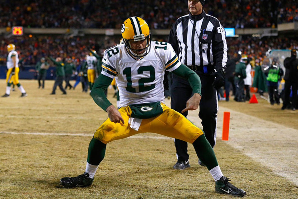 Aaron Rodgers celebrates two comebacks—his own and the Pack's. On to the postseason. (Jeff Haynes)