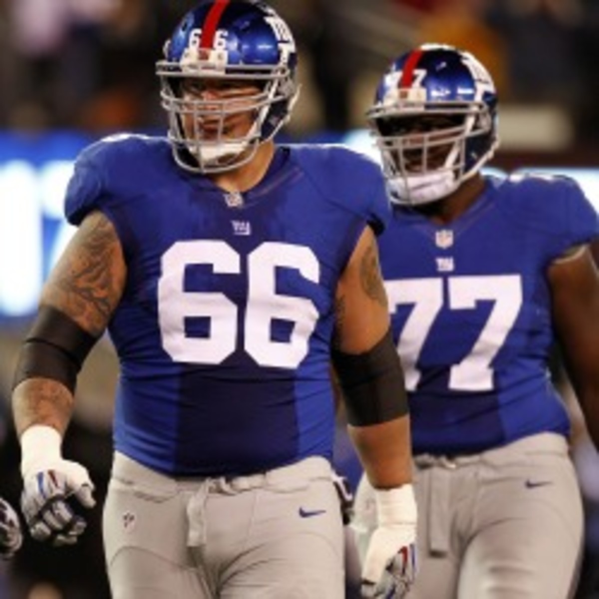 Giants right tackle David Diehl took a pay cut of $3.375 million to stay with the team. (Jeff Zelevansky/Getty Images)
