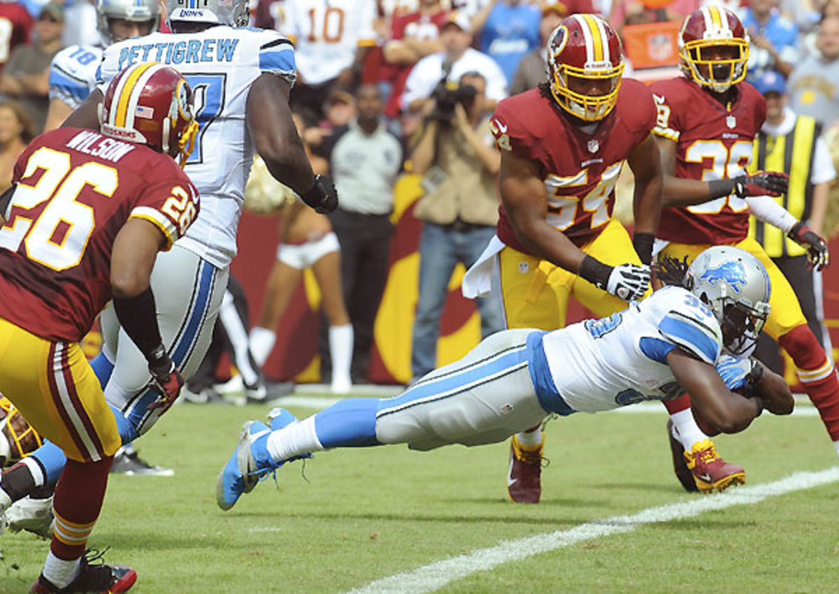 Joique Bell totaled 132 yards (63 rushing, 69 receiving) filling in for an injured Reggie Bush.