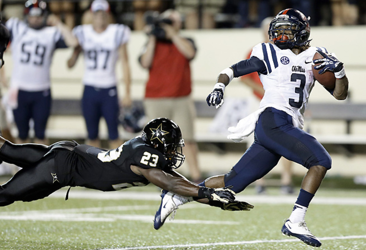 Mississippi RB Jeff Scott sheds the final tackle before scoring the game-winning 75-yard TD.